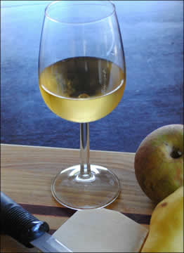 glass of white wine with fruit plate
