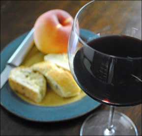 Red wine with biscotti and fruit