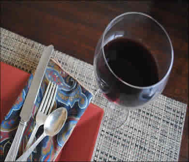 red wine glass with red dinner plate
