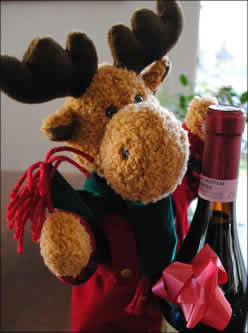 plush reindeer with a bottle of wine