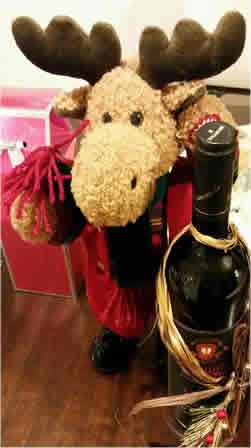 Plush reindeer with bottle of wine