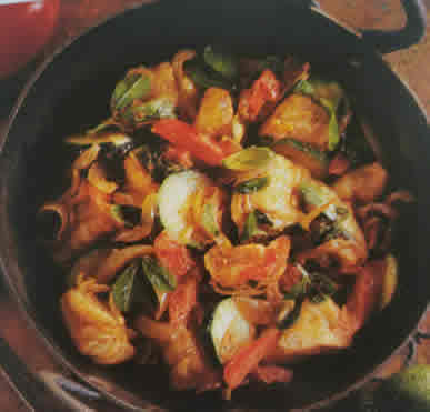 Bowl of stir-fried vegetables with cod fish.