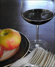 Wineglass with plate of fruit